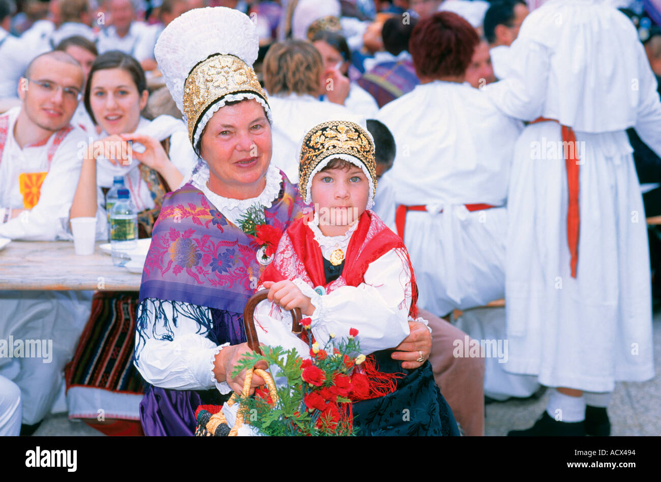woman and child with traditional slovenian costume at the music and