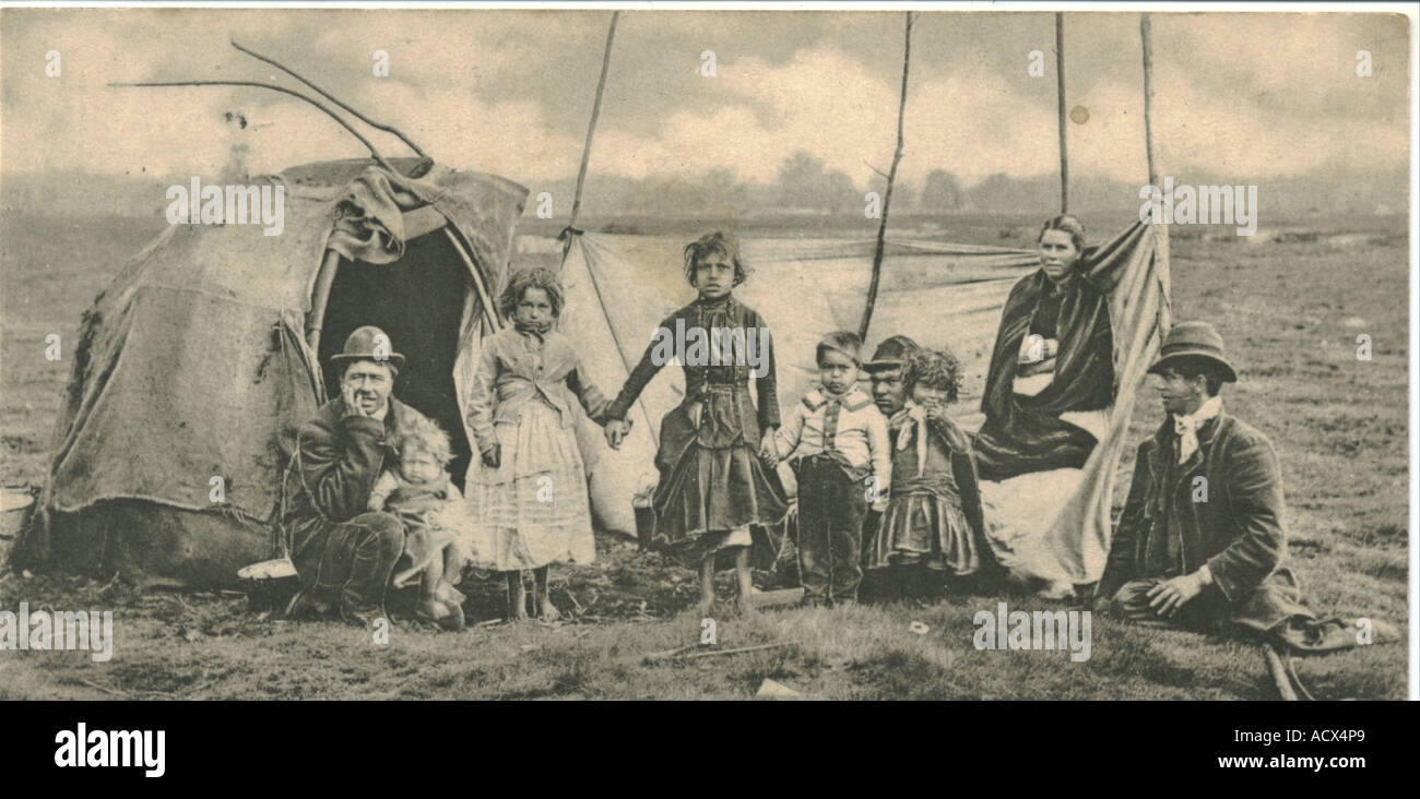Photographic postcard of a Gypsy family postally used 1902 - Stock Image