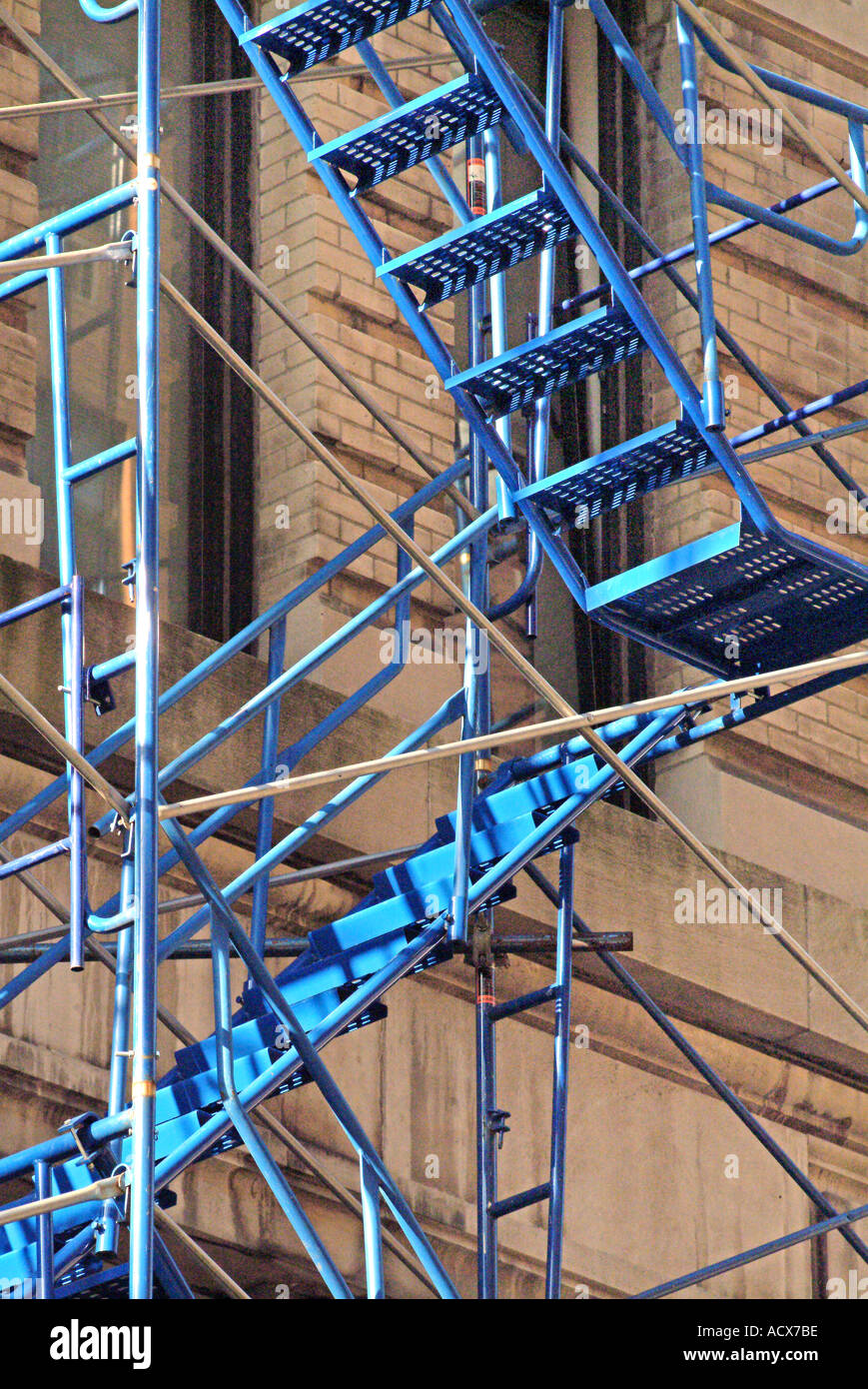 A Fire Escape Stairs And Scaffolding On Exterior Of Apartment Building    Stock Image