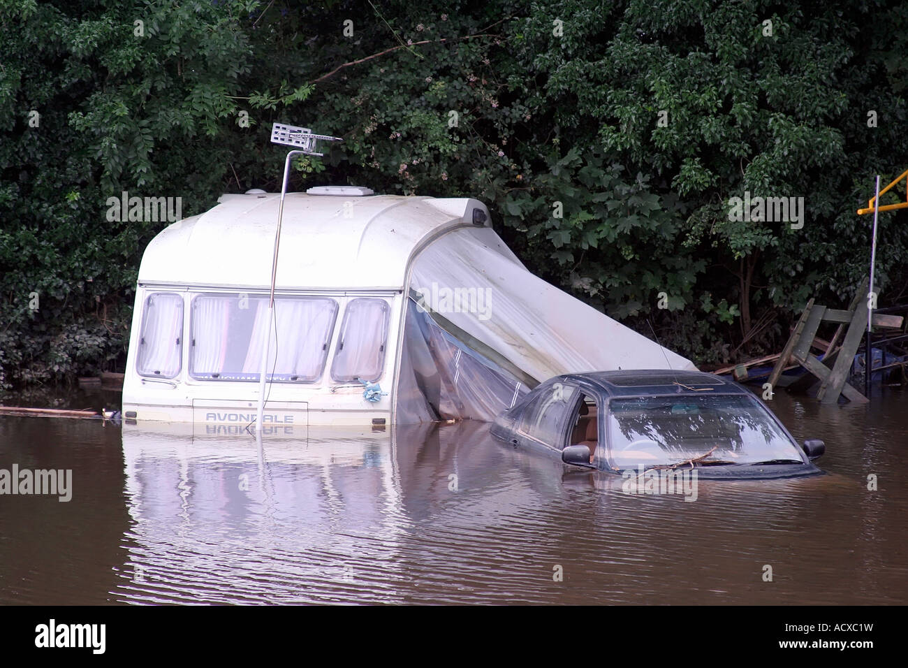 Caravan and car in flooded site at Upton Upon Severn Worcestershire during floods of July 2007 - Stock Image