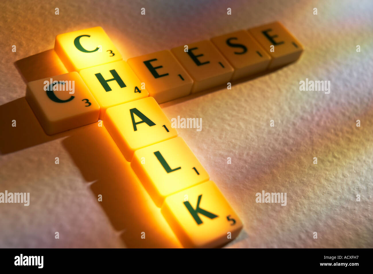 scrabble board game letters spelling the words chalk and cheese
