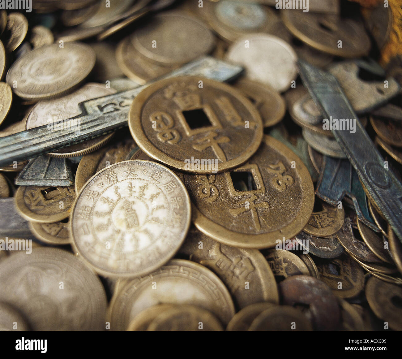 Gold and bronze old fashioned Chinese coins - Stock Image