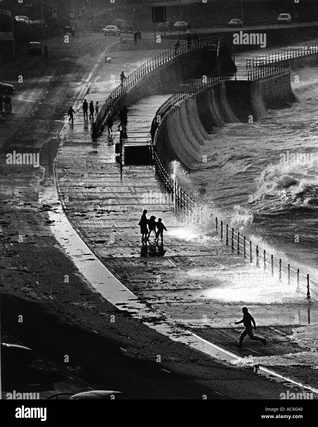 Heavy sea breaking over sea wall at Scarborough north bay - Stock Image