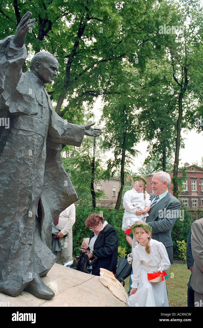 People at a statue of Pope John Paul II during the Corpus Christi procession, Poznan, Poland Stock Photo