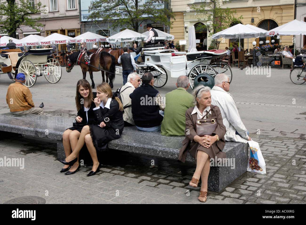 People in the Main Market Square in Cracow, Poland Stock Photo