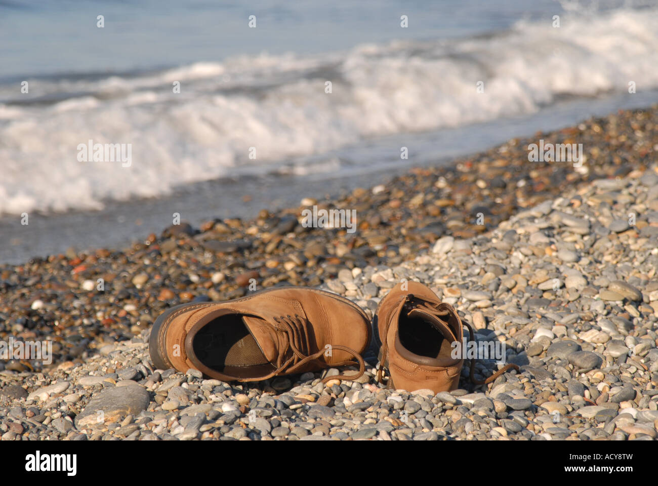 6b4aa69d6fc1 CRETE A pair of shoes on the beach at Maleme near Hania Stock Photo ...