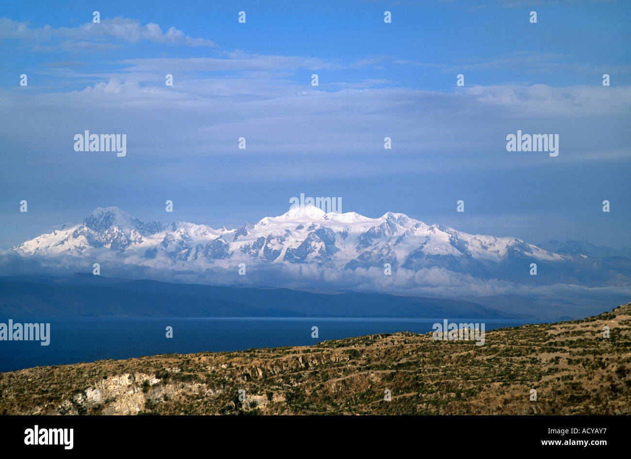 ISLE DEL SOL Island of the Sun with the NEVADO ILLAMPU 7010 M visible beyond the waters of LAKE TITICACA - Stock Image