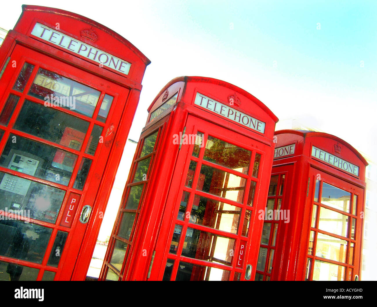 Three classic red phone boxes in Eastbourne Sussex England - Stock Image