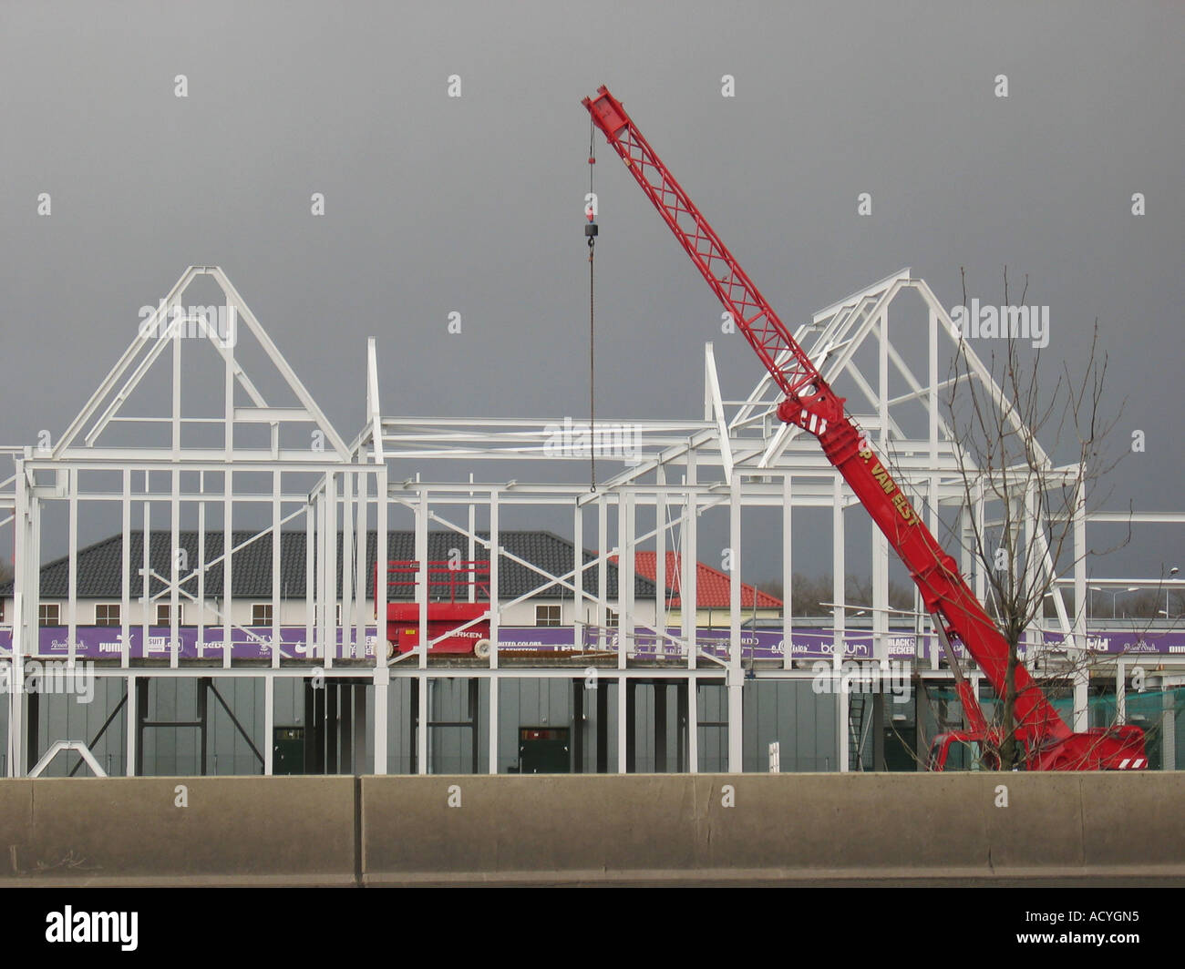 detail of house being built with crane and metal construction at building site Stock Photo