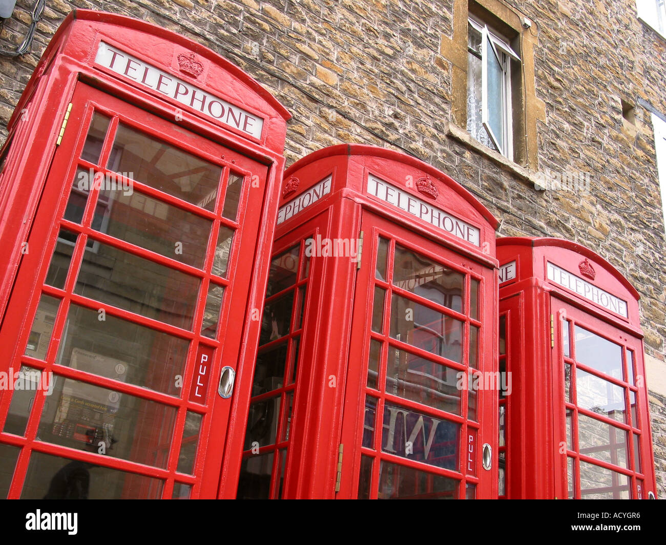 Detail of Three classic red phone boxes Hastings England - Stock Image