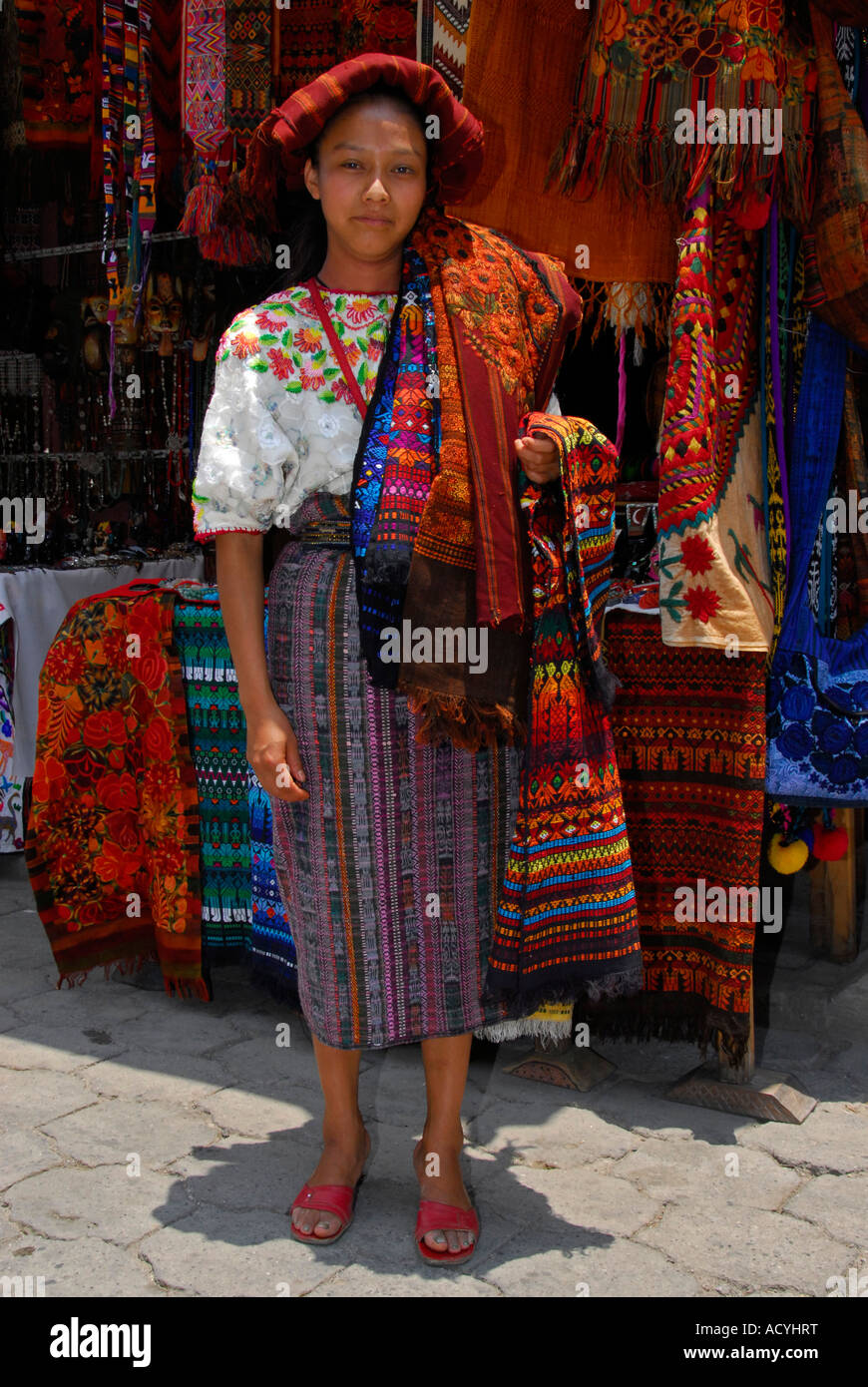 Indigenous woman selling textiles on the market in Chichicastenango, Guatemala, Central AmericaStock Photo