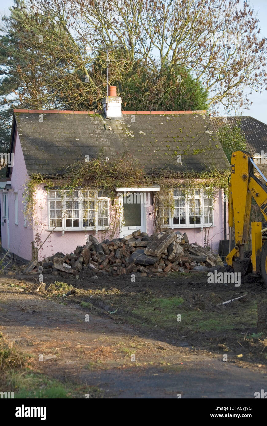 Redundant old between the war holiday village cottage sitting on valuable building plot about to be demolished for - Stock Image