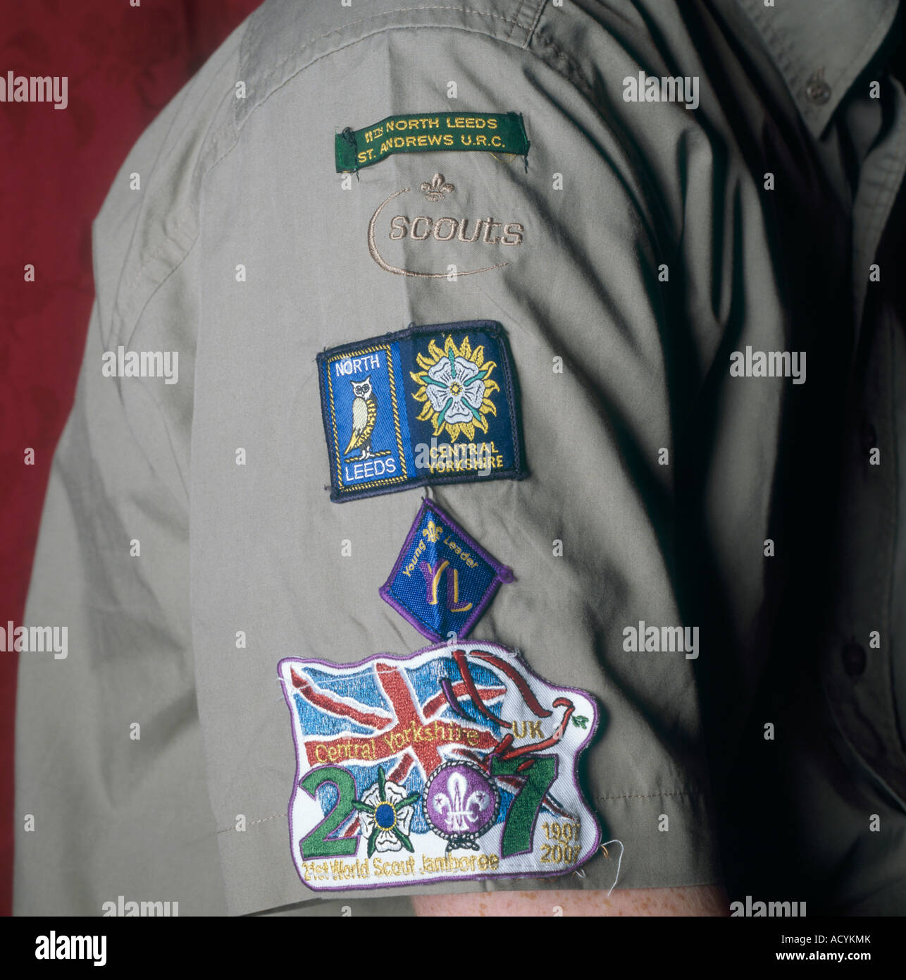 Boy scout with his range of badges for activities completed at the 11th North Leeds troop in Leeds West Yorkshire - Stock Image