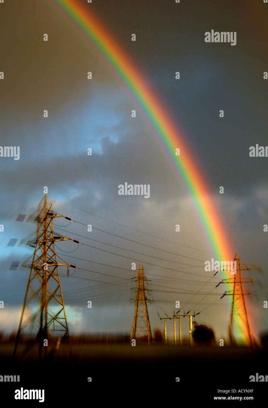 Rain bow over electricity Pylons Hales Norfolk England - Stock Image