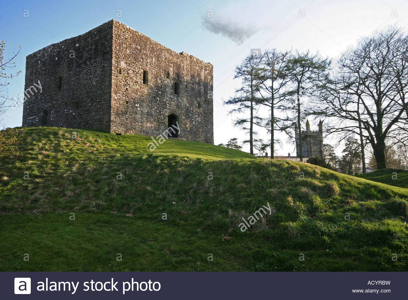 This image captures the commanding location of Lydford Castle, sited atop a steep hill in the village of Lydford, - Stock Image
