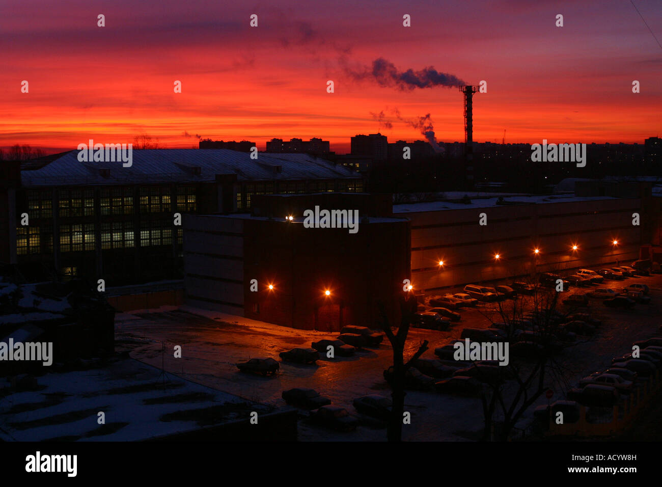 Moscow skyline at sunset showing industrial buildings polluting the atmosphere - Stock Image