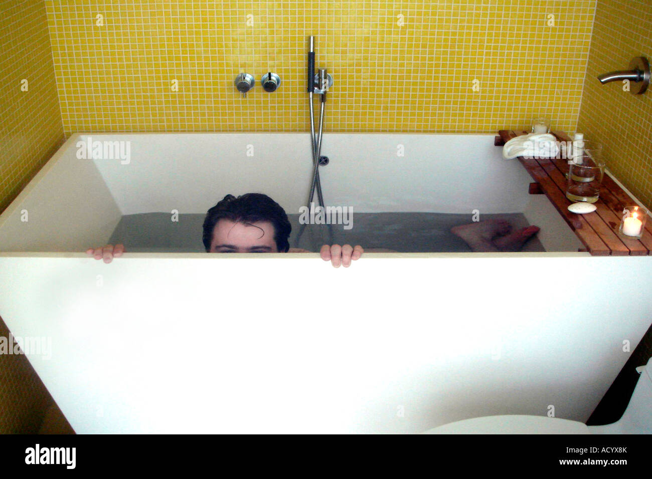 Man in a Japanese soaking tub Stock Photo: 13258434 - Alamy
