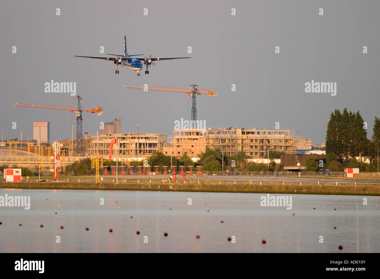 Turboprop-powered airliner on steep approach at London City Airport England UK - Stock Image