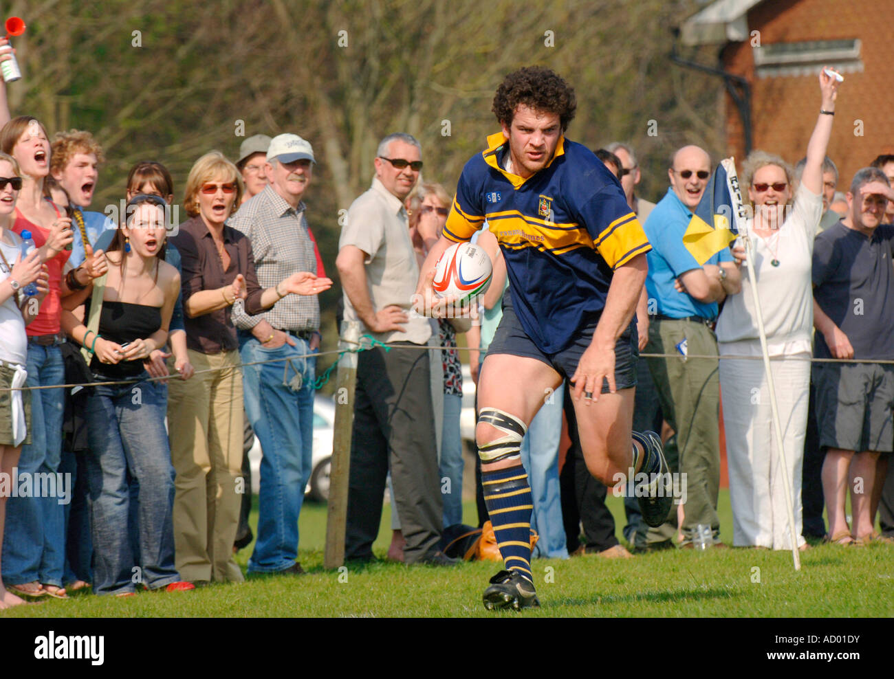 The crowd cheers as an Eastbourne rugby player is close to scoring a try. Picture by Jim Holden. - Stock Image