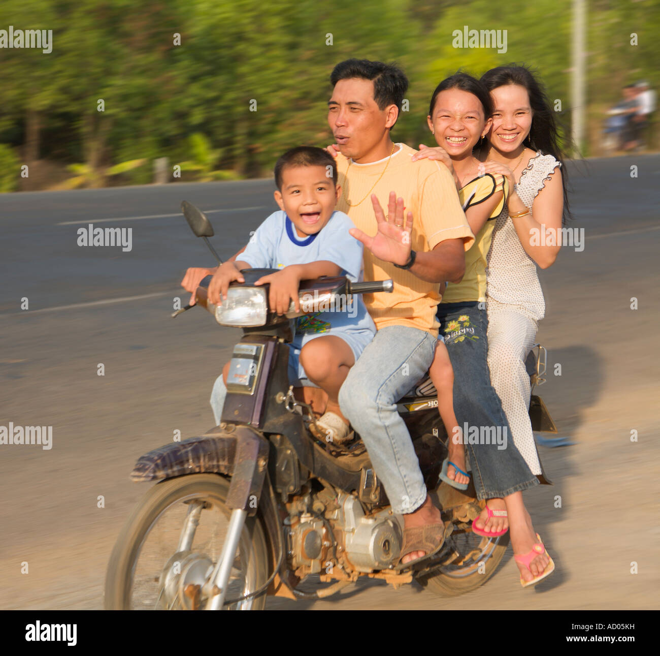 Family with children on motorbike riding along the road 'Central Highlands' 'Lam Dong Province' - Stock Image