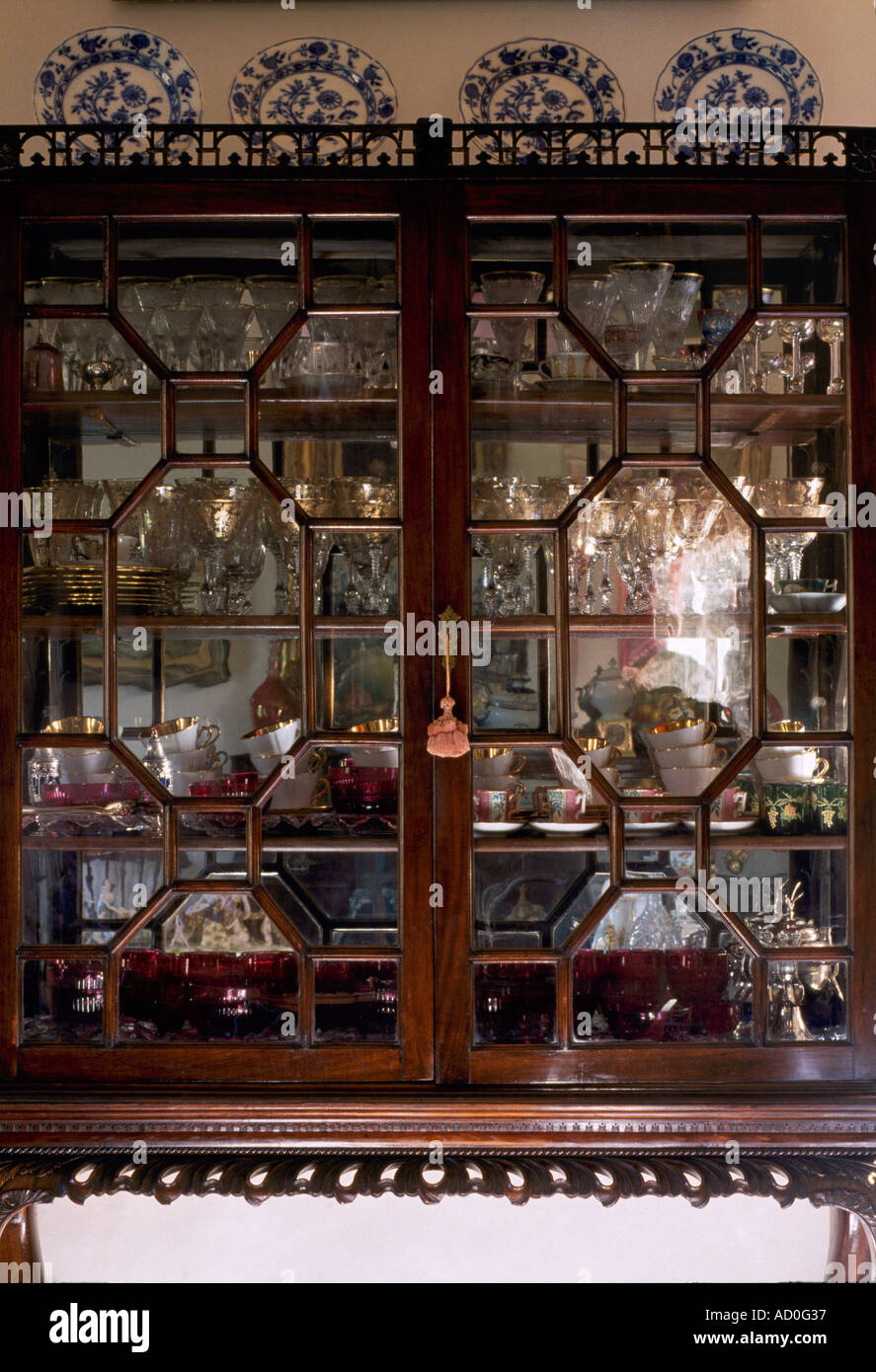 Waverley, Columbus, Mississippi, 1852. Detail of display cabinet with glassware and china in dining room. - Stock Image