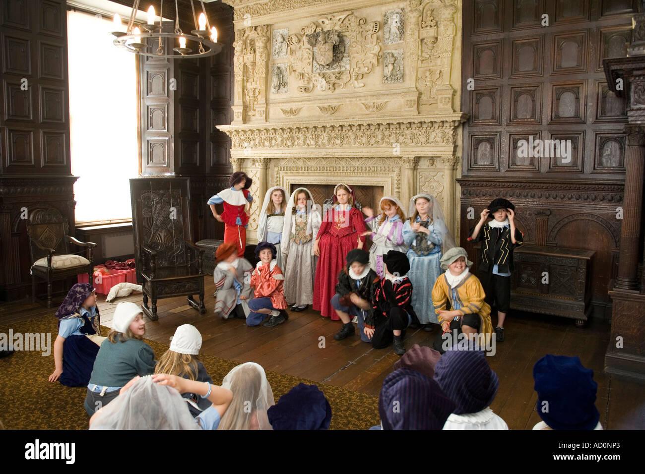 England Bristol West End Red Lodge Great Oak Room lesson for Elizabethan costumed schoolchildren - Stock Image