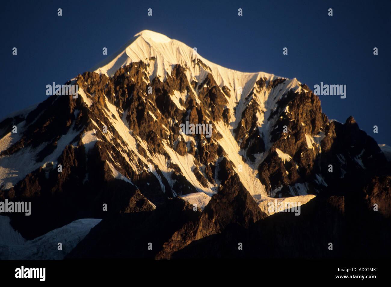 Mount Illimani North peak at sunset, Cordillera Real, Bolivia - Stock Image