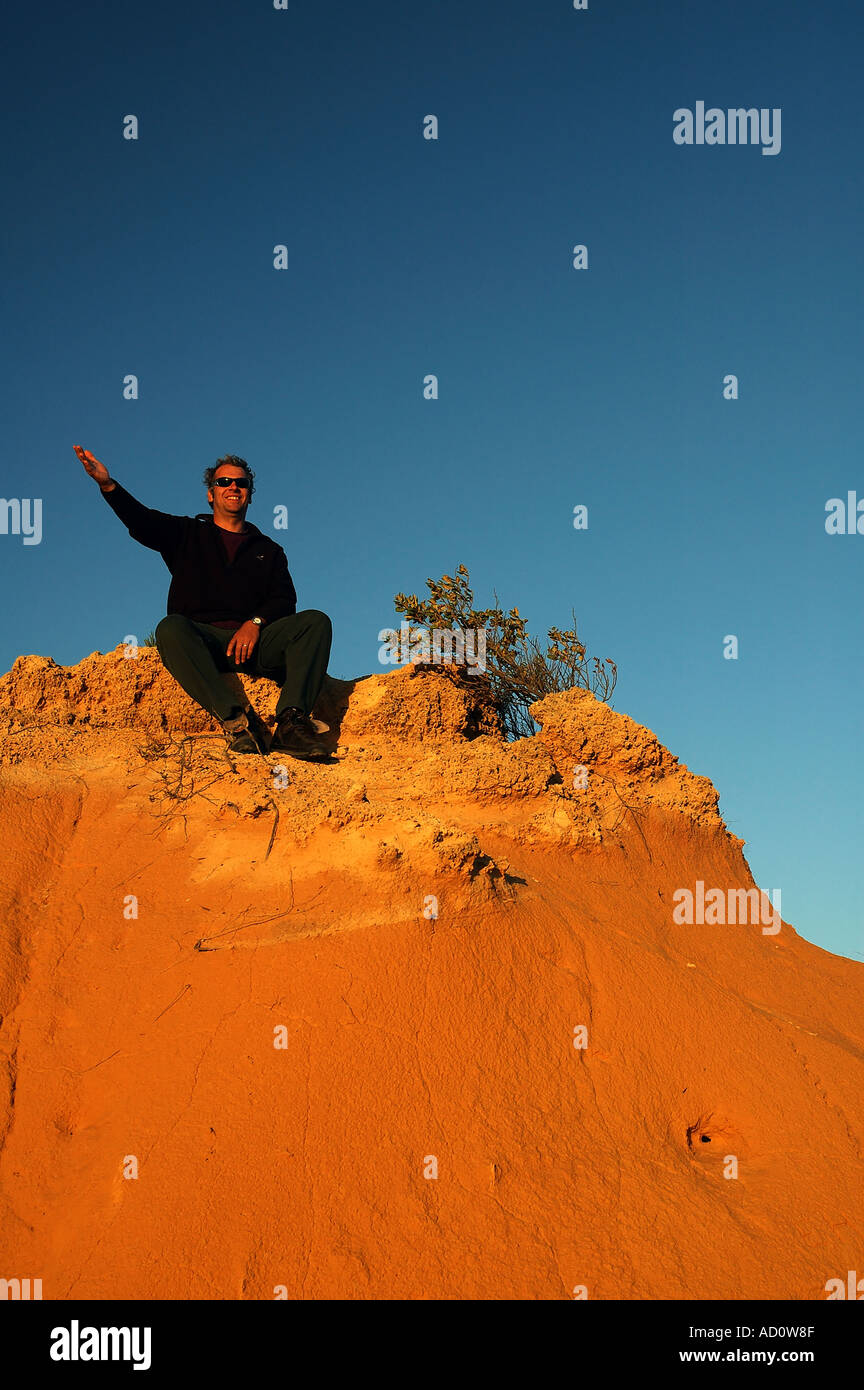 Ecotourist in The Pinnacles Desert at evening Nambung National Park Western Australia MR - Stock Image