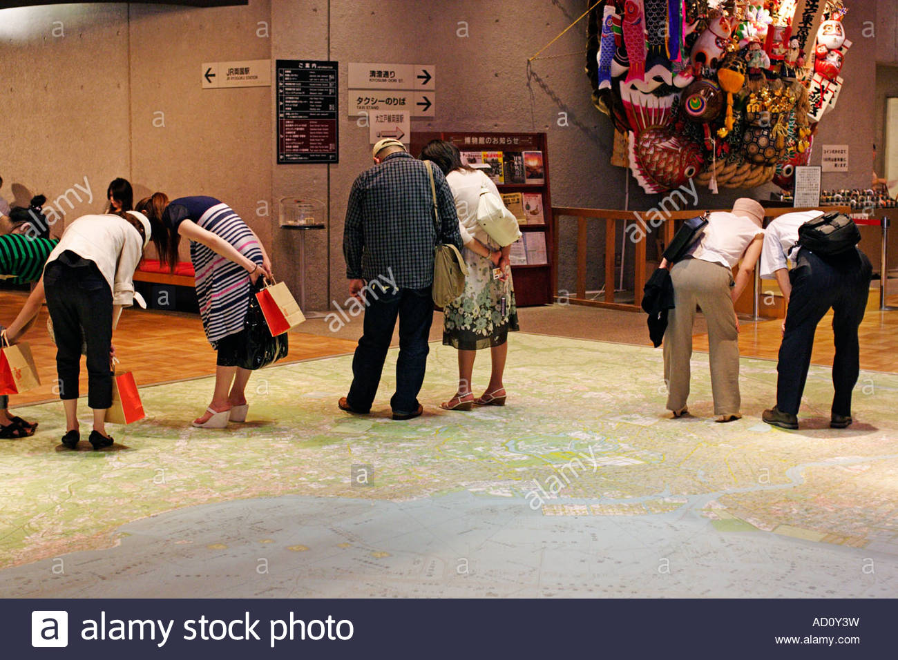In the Edo Tokyo Museum visitors study the city on a giant floor map; Ryogaku, Tokyo, Japan - Stock Image