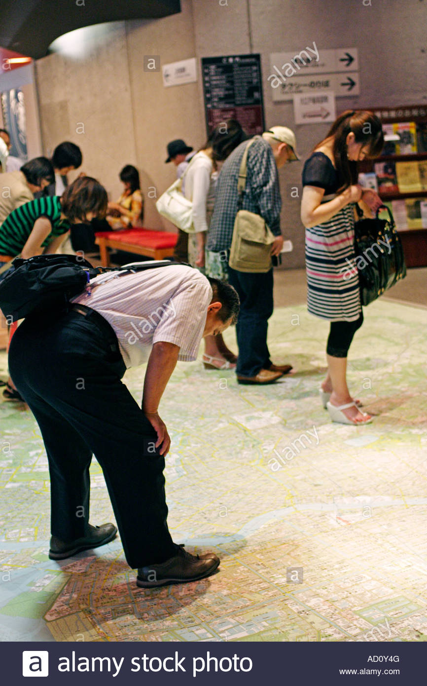 In the Edo Tokyo Museum, visitors study the city on a giant floor map; Ryogaku, Tokyo, Japan - Stock Image
