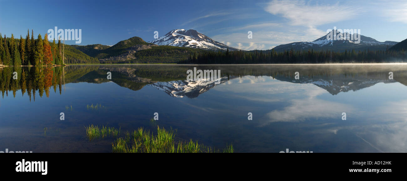 Sunrise panorama on Sparks Lake with South Sister and Broken Top mountains Deschutes National Forest Bend Oregon - Stock Image