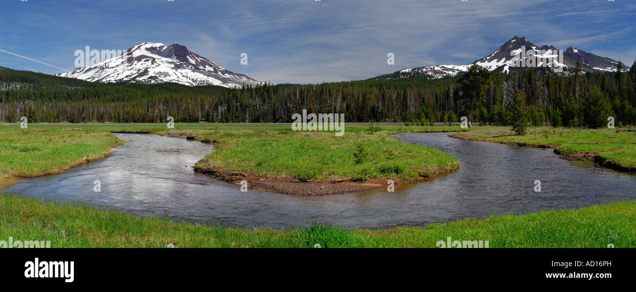 Panorama of Soda Creek at Sparks Lake meadow with South Sister and Broken Top mountains Deschutes National Forest - Stock Image