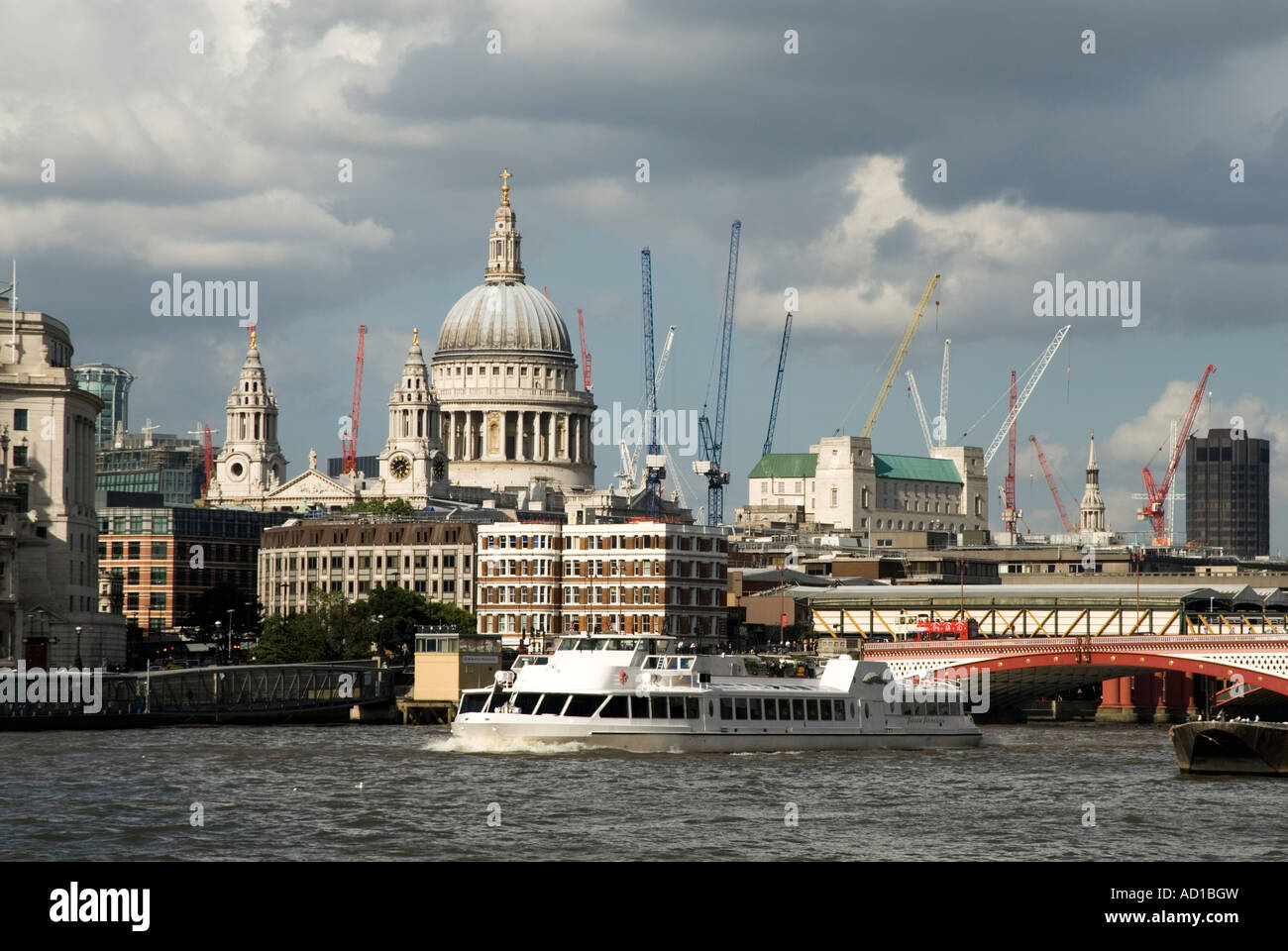 Construction cranes in the City of London England UK Stock Photo