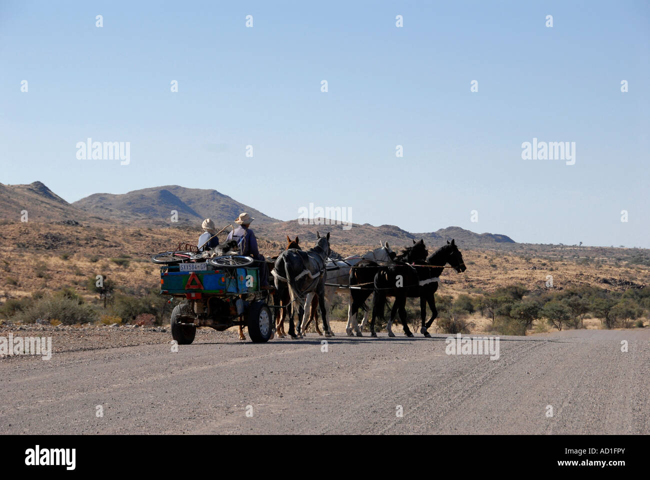 Itinerants on gravel road Namibia Southern Africa - Stock Image