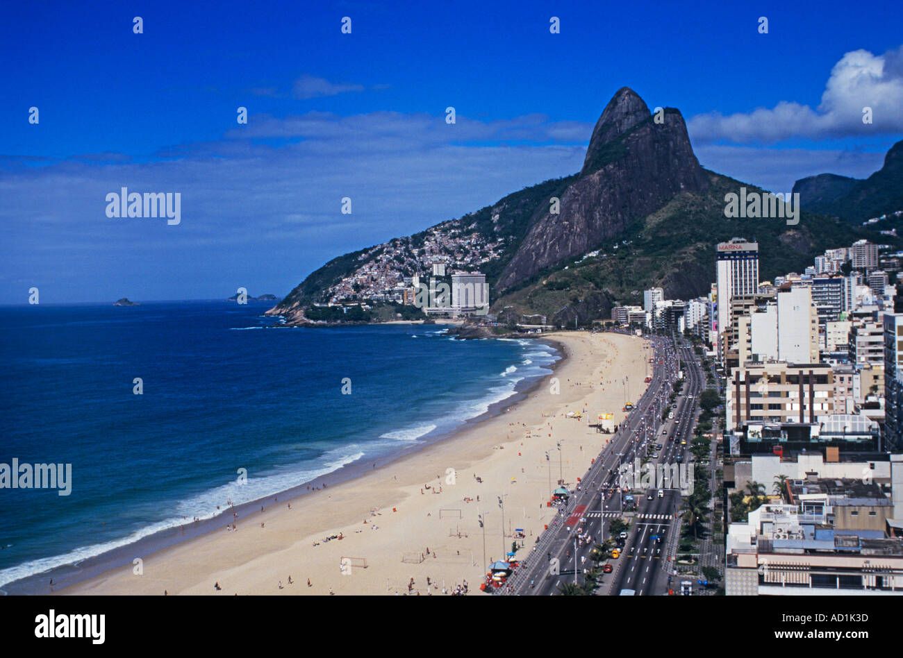 Ipanema, Rio de Janeiro's renowned beach looking to Leblon and the Two Brothers mountain - Stock Image