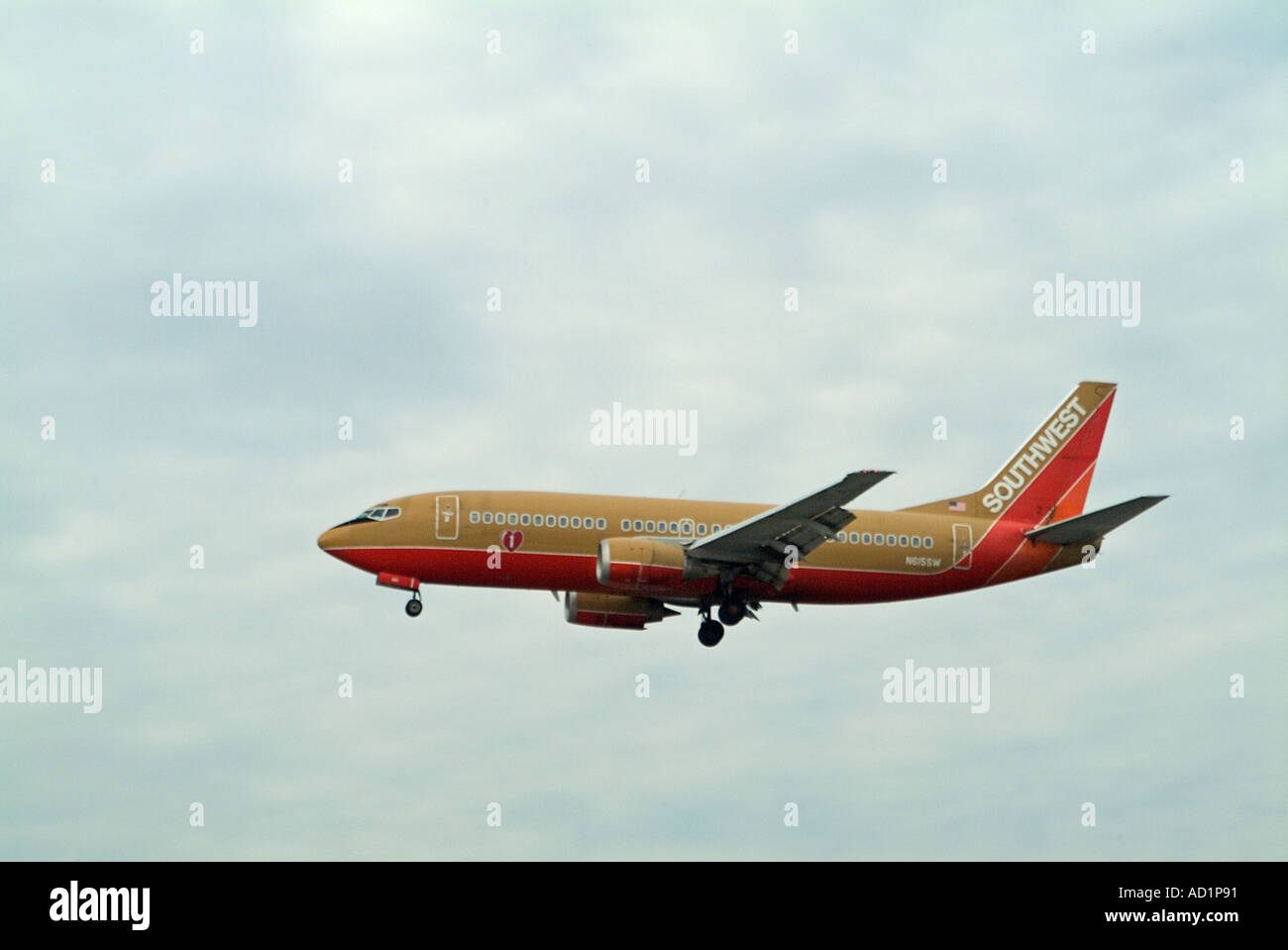 Southwest Airlines Airplane landing wheels down low altitude on approach to LAX - Stock Image