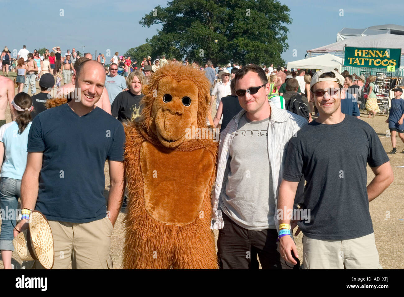Men with man in monkey suit at Guilfest music festival ...