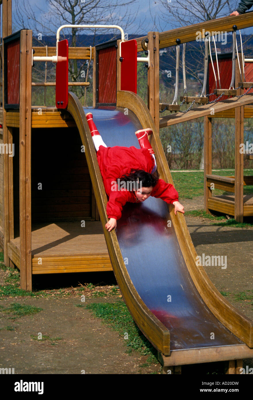 1, one, French girl, young girl, girl, child, at, play, playing, sliding pon, playground, Verneuil-sur-Seine, Ile - Stock Image