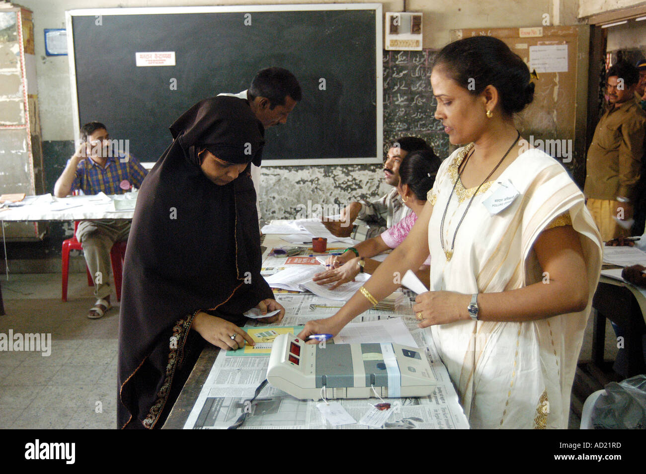 Indian Muslim woman being identified before voting in Elections India - Stock Image