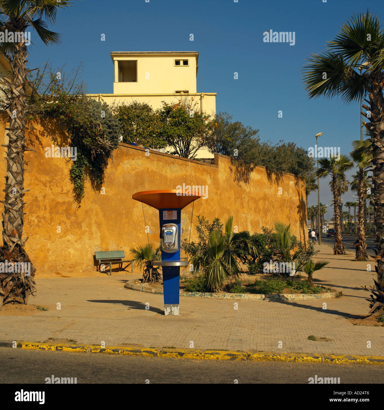 Modern telephone kiosk close to the medina - Stock Image