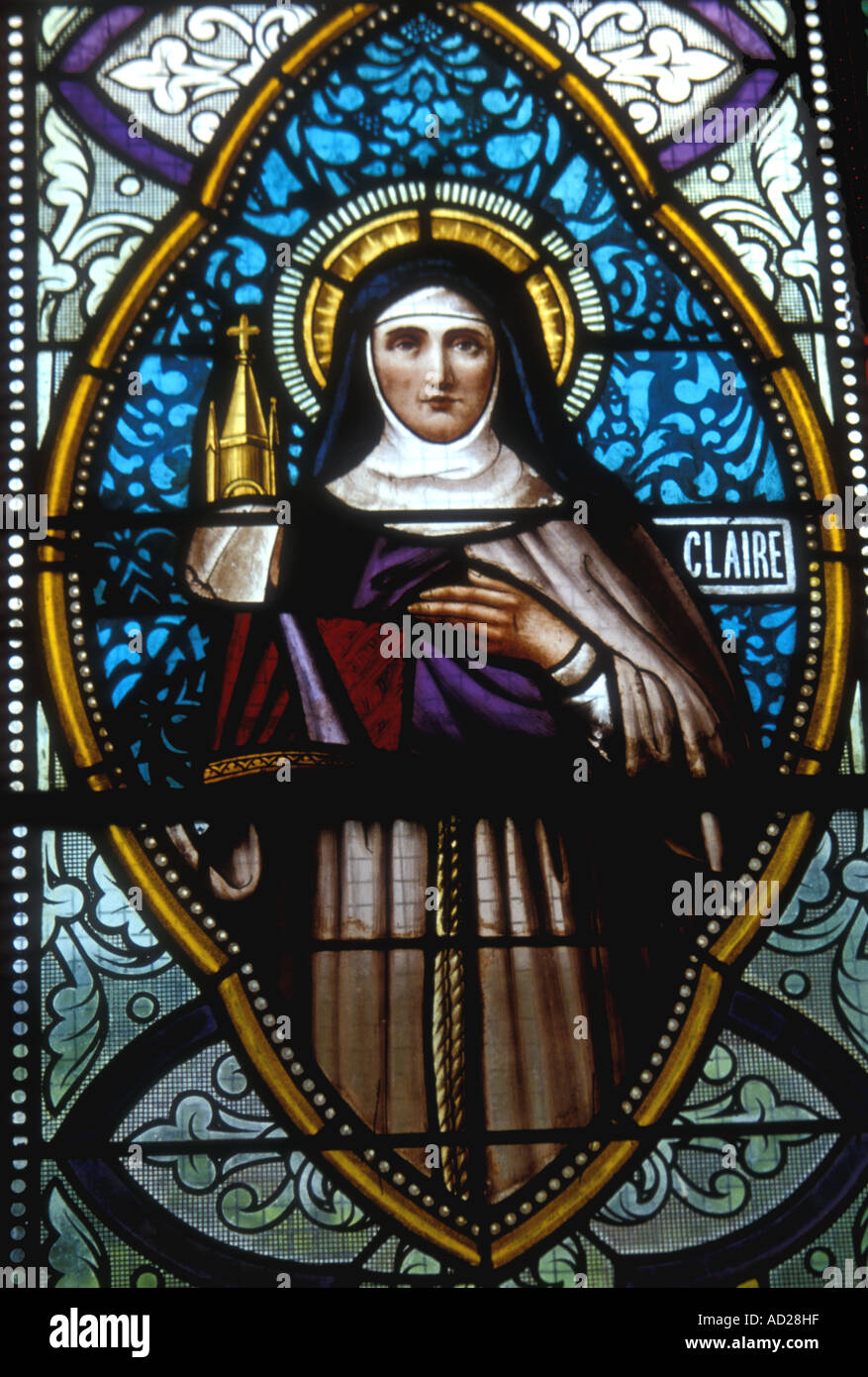 Saint Claire of Assisi, Patron Saint of Needleworkers, stained glass window of a church in the Seychelles - Stock Image