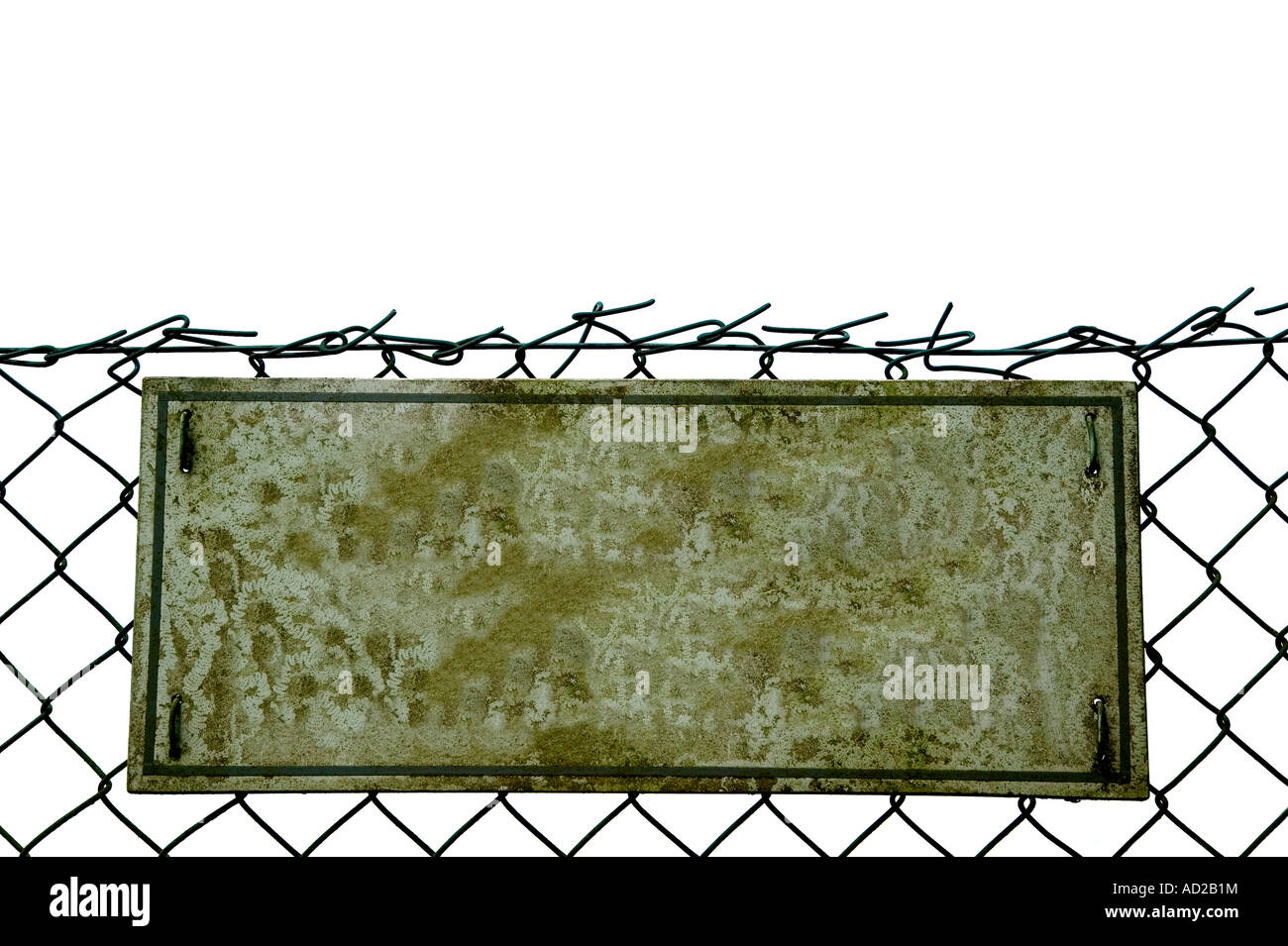 Blank Grungey old sign on a chainlink fence isolated on white - Stock Image
