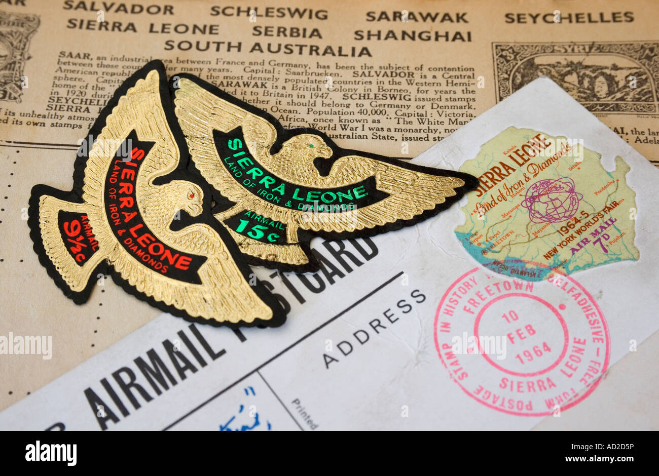 Worlds first free form self adhesive postage stamp from Sierra Leone with two eagle shaped Sierra Leone stamps - Stock Image