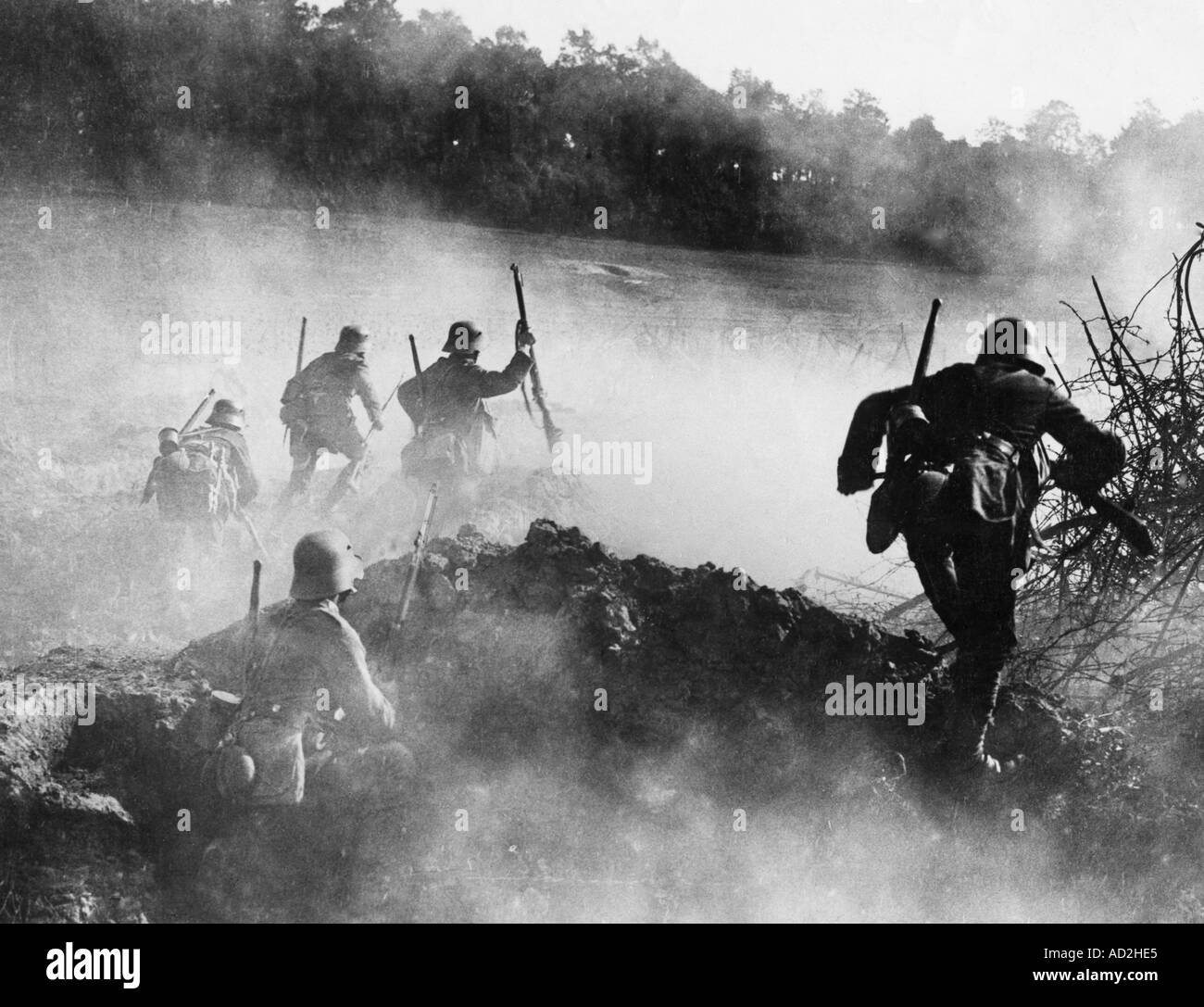 WWI German infantry assault on the Western Front 1918 They are wearing the steel helmets which had replaced the early Pickelha - Stock Image