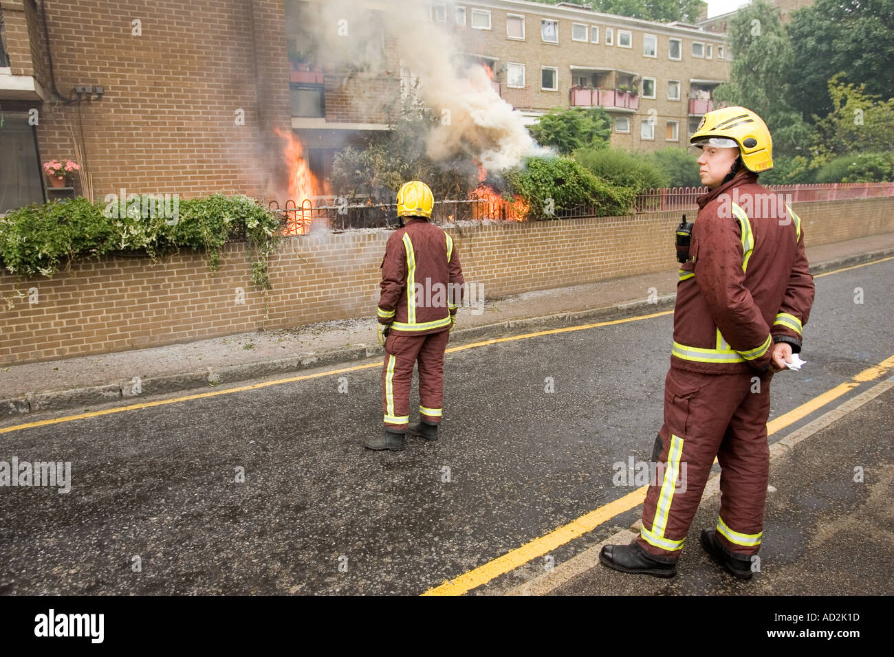 Fire brigade waiting for the water lorry to arrive closer to the fire south London - Stock Image