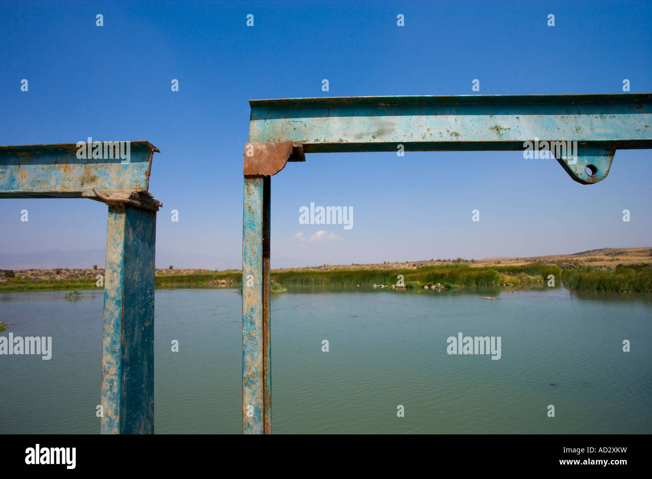 Gate posts to a reservoir lake - Stock Image