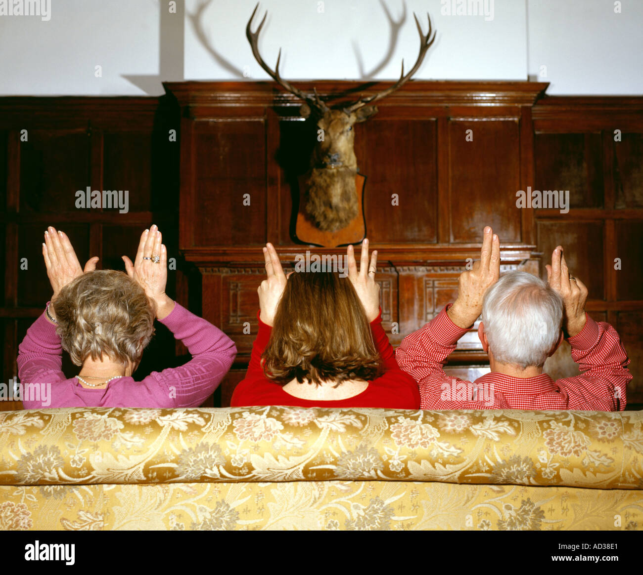 family pretending to be deer - Stock Image