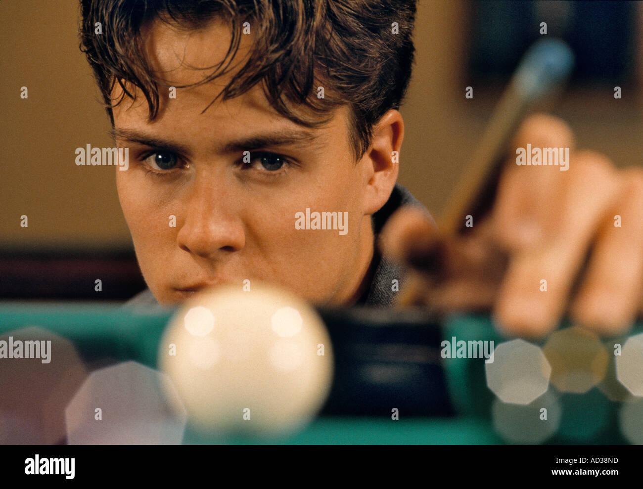 Young man playing pool. - Stock Image