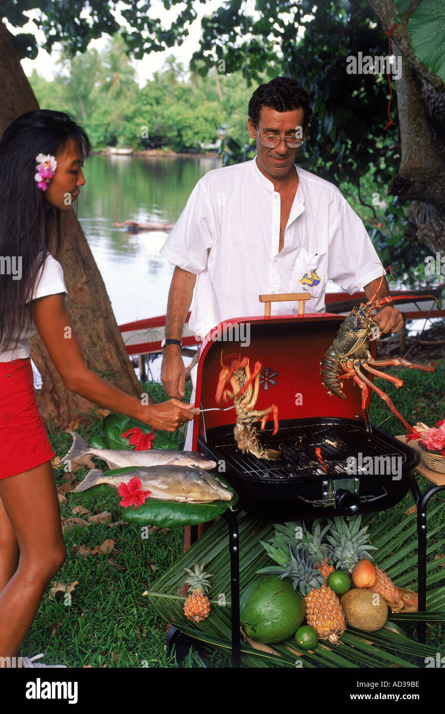 Grilled fresh lobster and fish on barbecue in French Polynesia  South Pacific - Stock Image