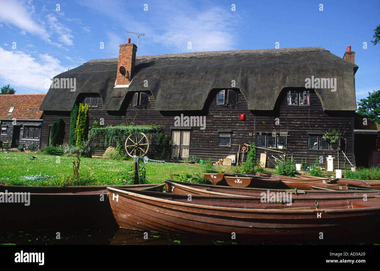 Thatched House on the River Stour near Flatford Mill Flatford Suffolk - Stock Image